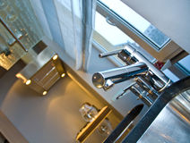 Modern kitchen detail. Details of the sink, faucet and counter in a modern kitchen Stock Photo