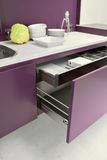 Modern kitchen. Detail of furniture in a modern kitchen with opened drawers Stock Images
