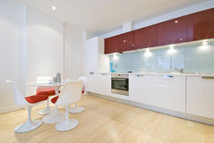 Modern kitchen diner. In a stylish warehouse conversion stock images