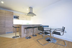 Modern kitchen with a dining area. Contemporary kitchen with a dining area Stock Image