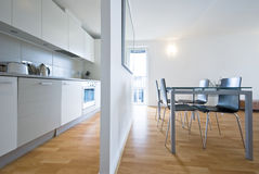 Modern kitchen and dining area Stock Photography