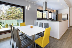 Modern kitchen with dinning room stock photos