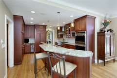 Modern kitchen with double decker island stock image