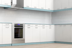 Modern kitchen. Kitchen equipped with modern electric cooker and range hood Stock Images
