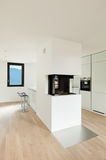 Modern kitchen with fireplace Royalty Free Stock Photography