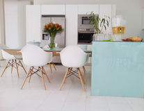 Modern kitchen. Dining room with flowers royalty free stock photography