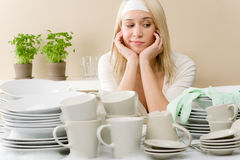 Modern kitchen - frustrated woman in kitchen Royalty Free Stock Images