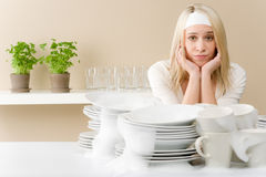 Modern kitchen - frustrated woman in kitchen stock photography