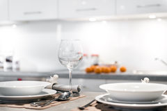 Modern kitchen with glass and plates Royalty Free Stock Photography