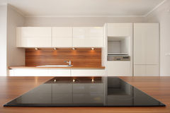 Modern kitchen. Glass stove top in modern kitchen Royalty Free Stock Image