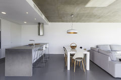 Modern kitchen with gray floor and white wall Stock Photography