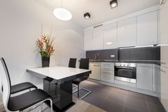 Modern kitchen with gray tile floor Stock Images