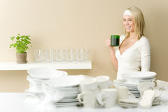 Modern kitchen - happy woman  having coffee break Stock Photo