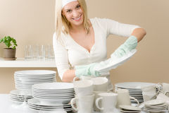 Modern kitchen - happy woman washing dishes Royalty Free Stock Photo