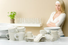 Modern kitchen - happy woman washing dishes Royalty Free Stock Images