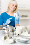 Modern kitchen - happy woman washing dishes Stock Images