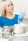 Modern kitchen - happy woman washing dishes Royalty Free Stock Photography