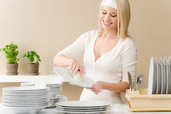 Modern kitchen - happy woman washing dishes Stock Photo