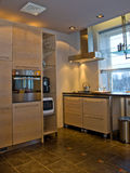Modern kitchen in home. Modern interior design of kitchen in home Royalty Free Stock Images