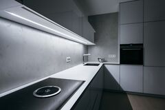 Free Modern Kitchen In White Color With Bright Light Strip Royalty Free Stock Photos - 200880168