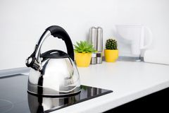 Modern kitchen with induction stove Stock Image