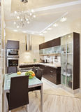 Modern Kitchen interior. In warm tones stock photography