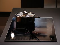 Modern kitchen interior. Stove with a pot royalty free stock photography