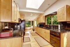 Modern kitchen interior with black granite tops Stock Photos