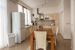 Modern kitchen interior with dinning room. Interior photography. Royalty Free Stock Photos