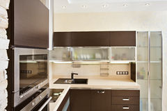 Modern Kitchen interior with hardwood Furniture Royalty Free Stock Image