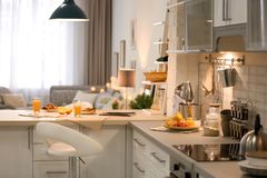 Modern kitchen interior. In stylish apartment stock image