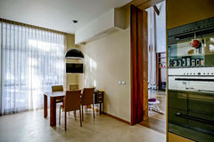 Modern kitchen interior in new house. Fiberglass doors. Stock Photo