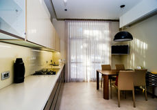 Modern kitchen interior in new house. Fiberglass doors. Stock Images