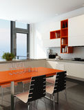 Modern kitchen interior with orange and white furniture Stock Photos