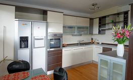 Modern Kitchen. Interior of stylish modern house, kitchen Royalty Free Stock Images