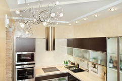 Modern Kitchen interior in warm tones stock photography