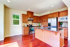 Modern kitchen with island and granite tops Stock Photos