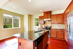 Modern kitchen with island and granite tops Royalty Free Stock Images