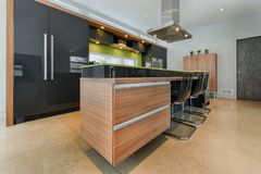 Modern kitchen island with integrated drawers Stock Image