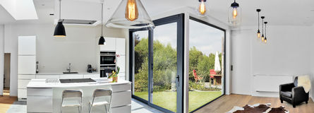 Modern kitchen from loft with view on a lush garden. Open modern kitchen from loft with view on a lush garden Stock Images