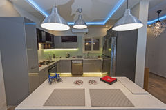 Modern kitchen in a luxury apartment Stock Images