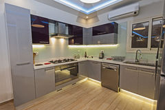 Modern kitchen in a luxury apartment Royalty Free Stock Photos