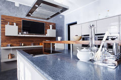 Modern kitchen in luxury mansion. Interior of modern kitchen in luxury mansion Royalty Free Stock Image
