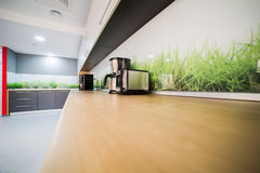 Modern kitchen. A modern kitchen in an office building with coffee maker royalty free stock photography