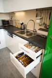 Modern kitchen with open drawers.  Stock Photo