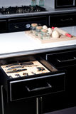 Modern kitchen with opened drawer. Set of kitchen utensils in a modern kitchen Royalty Free Stock Photography
