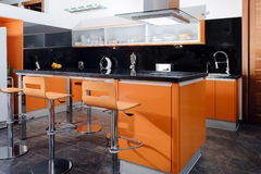 Modern kitchen in orange. Horizontal composition of a modern and elegant kitchen in orange royalty free stock image