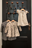 Little Dresses. 3 little dresses hanging on a door royalty free stock photography