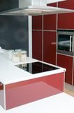 Modern kitchen with oven in red tones Stock Image