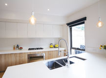 Modern kitchen with pendant lighting and sunken sink Stock Images